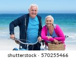 mature couple with bicycles on... | Shutterstock . vector #570255466