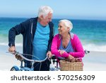 mature couple with bicycles on... | Shutterstock . vector #570256309