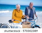 senior couple with bikes at the ... | Shutterstock . vector #570302389