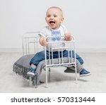 Cute Curious Baby Boy Sitting...