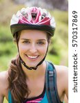 smiling woman wearing a helmet... | Shutterstock . vector #570317869