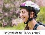 smiling woman wearing a helmet... | Shutterstock . vector #570317893