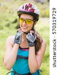 woman touching her helmet in... | Shutterstock . vector #570319729