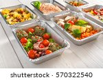 Small photo of Healthy food background. Take away of natural organic meals in foil boxes. Fitness nutrition, meat, fresh salads, fruits and vegetables. Restaurant dishes delivery