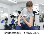 teenage boy engaged in the gym... | Shutterstock . vector #570322873
