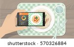 hand holding a smartphone ... | Shutterstock .eps vector #570326884
