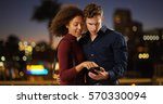 young romantic couple using...   Shutterstock . vector #570330094