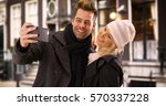 happy yuccie couple taking... | Shutterstock . vector #570337228