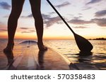 paddle board on the beach ... | Shutterstock . vector #570358483
