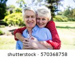 happy senior couple embracing... | Shutterstock . vector #570368758