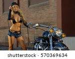 sexy motorcycle biker girl... | Shutterstock . vector #570369634