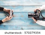 old and new camera. concept of... | Shutterstock . vector #570379354