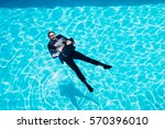 dressed businessman in swimming ... | Shutterstock . vector #570396010