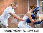 woman receiving massage in... | Shutterstock . vector #570396160