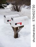 snow covered mailboxes in a...   Shutterstock . vector #570402730