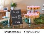 pink wedding reception cupcakes ...   Shutterstock . vector #570403540