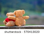 Two Teddy Bears Sitting On The...