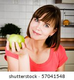 Young happy woman with apple - stock photo