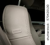 Small photo of Car leather seat detail with airbag sign.