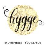 hygge hand lettering on golden... | Shutterstock .eps vector #570437506