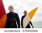 senior couple in wetsuit... | Shutterstock . vector #570442060