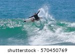 riding on the waves. costa rica ...   Shutterstock . vector #570450769