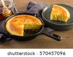 Stock photo slice of sweet cornbread with honey on the plate 570457096