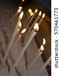 candles burning at a church for ... | Shutterstock . vector #570461773