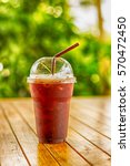 Small photo of Iced Americano black coffee on a wooden table
