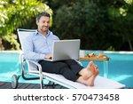 smart man relaxing on sun... | Shutterstock . vector #570473458