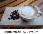 a cup of coffee with flower... | Shutterstock . vector #570495874