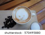 a cup of coffee with flower... | Shutterstock . vector #570495880