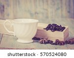coffee beans on wood table  | Shutterstock . vector #570524080