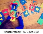 little girl playing with puzzle ... | Shutterstock . vector #570525310