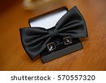 black cuff links and bowtie | Shutterstock . vector #570557320