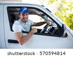 portrait of of smiling delivery ... | Shutterstock . vector #570594814