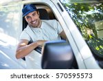 portrait of cheerful delivery... | Shutterstock . vector #570595573