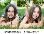 two teenage twin sisters lying... | Shutterstock . vector #570605974