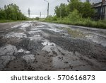 Puddles  Potholes  On The Road  ...