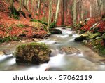 isolated rock into the stream in autumn - stock photo