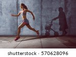 young runner with an old shadow | Shutterstock . vector #570628096