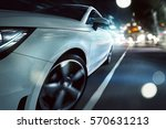 sportscar drives through a... | Shutterstock . vector #570631213