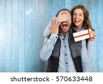 woman giving surprise gift to... | Shutterstock . vector #570633448