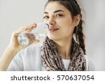 young woman drinking water | Shutterstock . vector #570637054