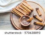 churros   famous spanish... | Shutterstock . vector #570638893