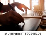 graphic designer working on... | Shutterstock . vector #570645106