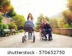 young parents in wheelchair... | Shutterstock . vector #570652750