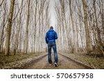 Man Walking Alone In A Poplar...