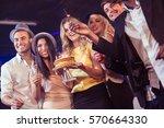 happy friends celebrating... | Shutterstock . vector #570664330