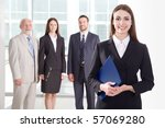 business woman in an office... | Shutterstock . vector #57069280